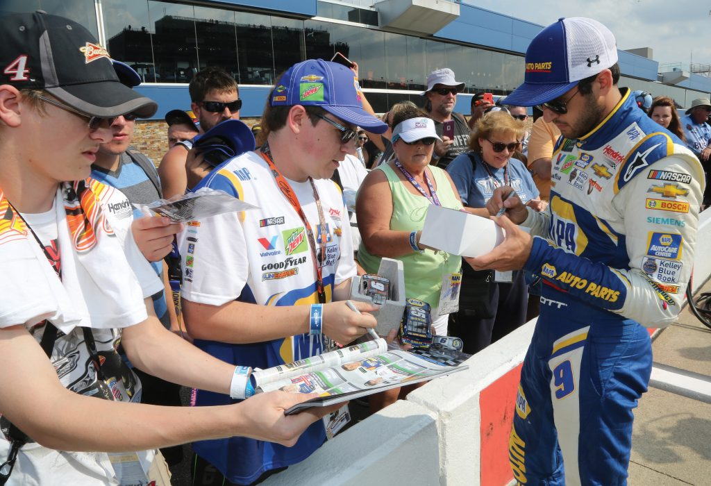 BROOKLYN, MI - AUGUST 10: Chase Elliott, driver of the #9 NAPA Auto Parts Chevrolet, signs autographs during qualifying for the Monster Energy NASCAR Cup Series Consmers Energy 400 at Michigan International Speedway on August 10, 2018 in Brooklyn, Michigan. (Photo by Jerry Markland/Getty Images) | Getty Images