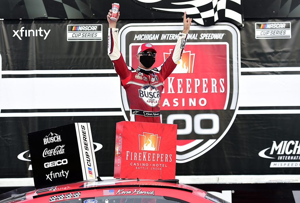 BROOKLYN, MICHIGAN - AUGUST 08: Kevin Harvick, driver of the #4 Busch Light Apple Ford, celebrates in Victory Lane after winning the NASCAR Cup Series FireKeepers Casino 400 at Michigan at Michigan International Speedway on August 08, 2020 in Brooklyn, Michigan. (Photo by Jared C. Tilton/Getty Images) | Getty Images